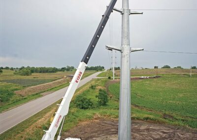 e 120 truck working on electrical tower