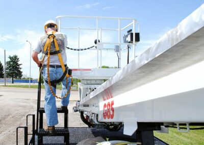 construction worker stepping up to basket on G 85 truck