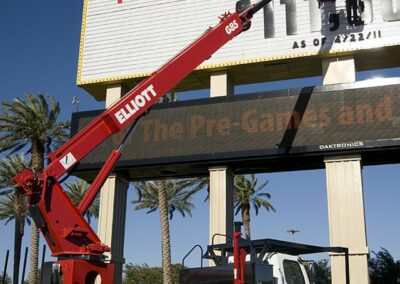 workers changing letters on marquee using a red g 85 truck