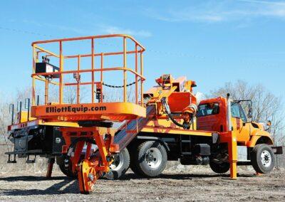 orange H 55 truck with platform near ground