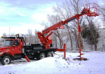 h 55 r digger drilling in snow