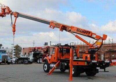 Orange H 55 R truck with drill attachment