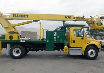 custom yellow h 70 truck shown from side