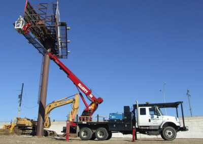 H 90 truck being used to install billboard