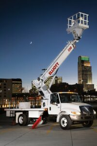 I 50 F hireach truck with city and moon in background