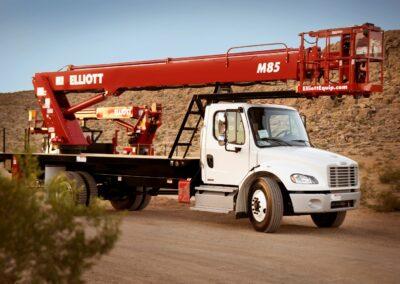red m 85 truck in desert